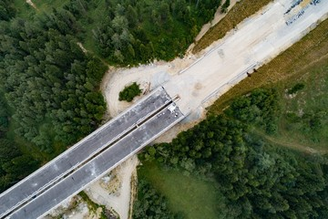 Drone aerial view on road and viaduct in construction.