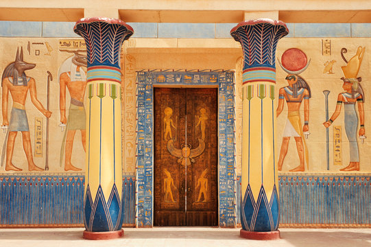 Ancient egypt scene. Hieroglyphic carvings on the exterior walls of an ancient egyptian temple.