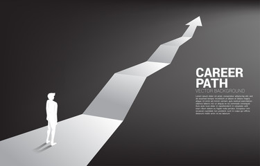 Silhouette of businessman standing on forward arrow. Concept of career path and start business Wall mural