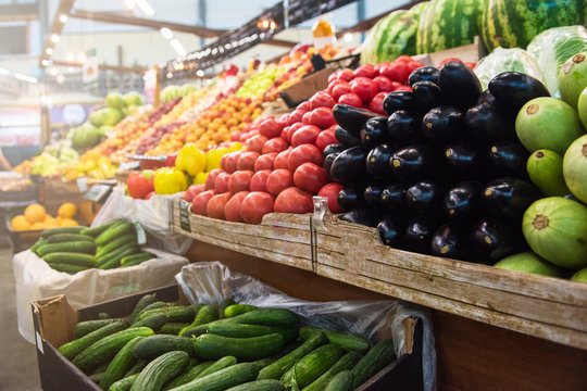 Vegetable farmer market counter: colorful various fresh organic healthy vegetables at grocery store. Healthy natural food concept
