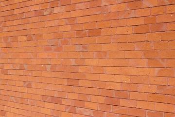 Traditional vintage reddish orange brick wall texture background with weathered and worn bricks...