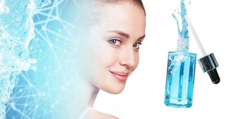 Young woman near blue cosmetic bottle under blue water splash.