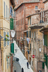 Fototapete - Medieval Street in historical city Siena, Tuscany, Italy
