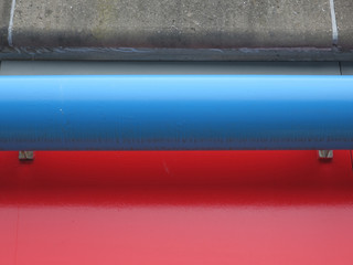 edge of a viaduct painted red wit a blue balustrade