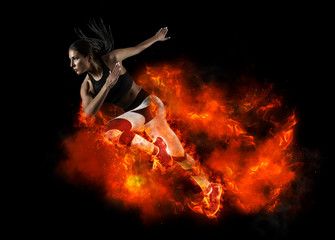 Woman running on fire background