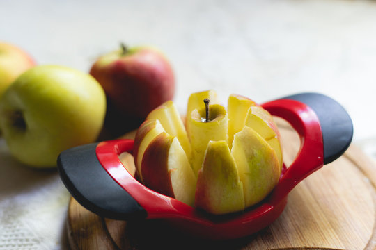 round apple slicer on a board, making eight segments for breakfast