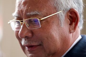 Former Malaysia's Prime Minister Najib Razak leaves Kuala Lumpur High Court in Kuala Lumpur