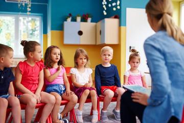 Group of children and teacher  in the preschool