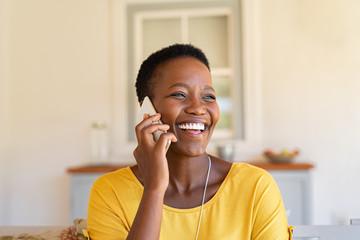 Fototapeta Woman laughing while talking on phone obraz