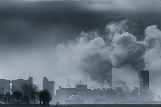 A chemical plant polluting the air and causing rising temperatures and global warming