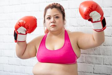 fat asian girl do boxing