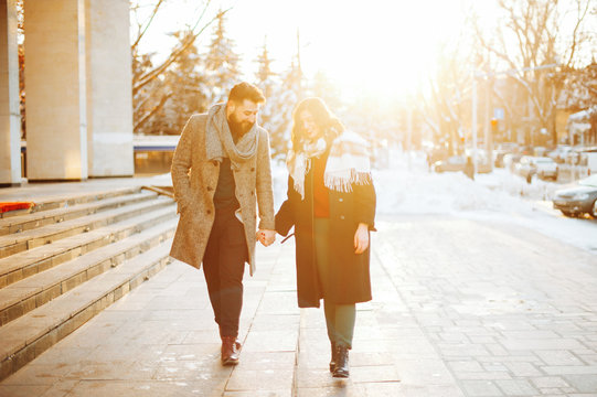 Photo of winter walking, of two persons, of a couple, holding hands