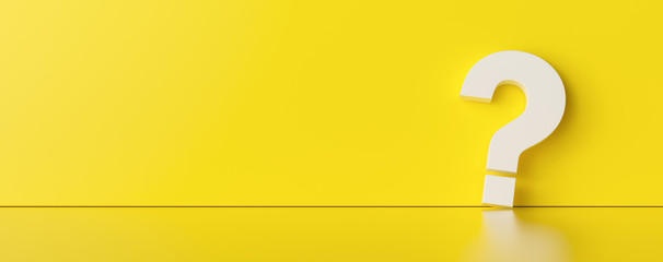Question mark on yellow wall background  - FAQ Concept image