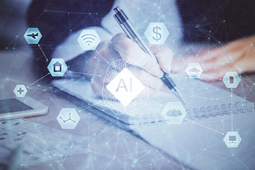 Double exposure of writing hand on background with data technology hologram. Big data concept.