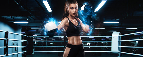 Sportsman, woman boxer fighting in gloves. on ring. Boxing and fitness concept.