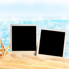 photo frames on the sea sand on the beach background