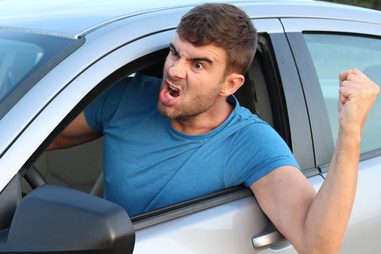 Male driver arguing with someone