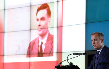 Bank of England governor Mark Carney presents the image of mathematician Alan Turing who will appear on a new 50 pound note at the Science and Industry Museum in Manchester