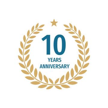 10 th years anniversary badge design with a laurel wreath. Ten years birthday logo emblem.