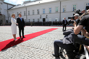 Poland's President Duda and Slovakia's President Caputova shake hands at the Presidential Palace in Warsaw