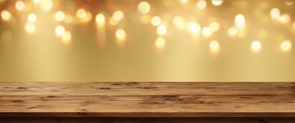 Golden bokeh background with rustic table
