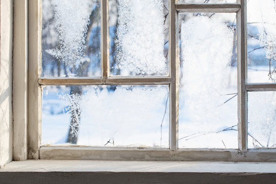 old wooden window with winter frost