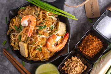Home Made Pad thai with Shrimp and Vegetables on Marble table