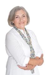Portrait of emotional senior woman posing isolated