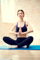 Girl exercising or meditating at home