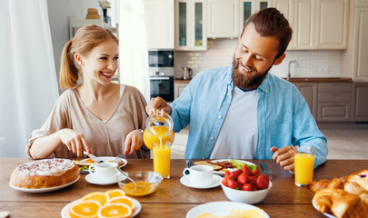 family happy couple have Breakfast in kitchen in morning