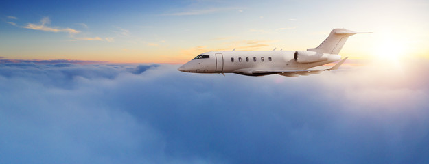 Private jet plane flying in sunset Wall mural