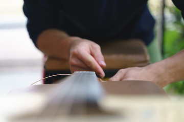 Changing acoustic guitar chord.
