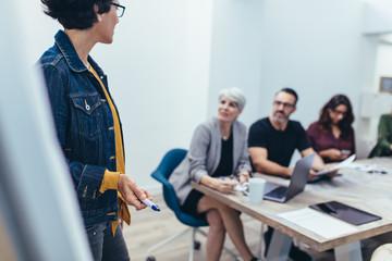 Female executive sharing new ideas