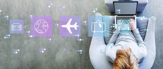 Airplane travel theme with man using a laptop in a modern gray chair