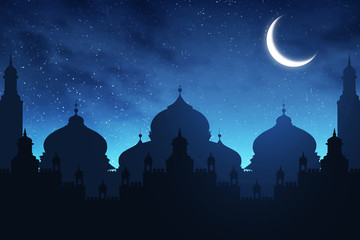 Silhouette of mosque at night