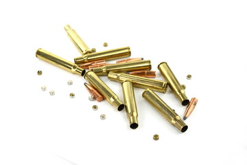 A rifle bullet, empty shell on white background. Hunting ammunition isolated on white.