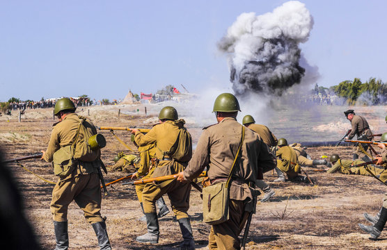 Explosions of bombs and shells. Reconstruction of the battle of world war II. Battle for Sevastopol. Reconstruction of the battle with explosions. Tanks and soldiers during the battle.