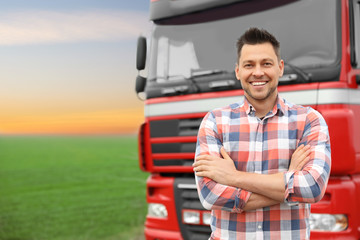 Portrait of driver at modern truck outdoors. Space for text Fototapete