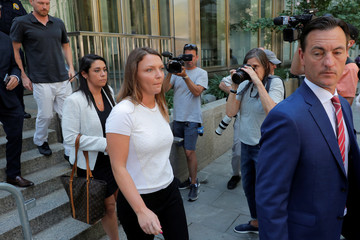 Courtney Wild leaves the courthouse after a bail hearing in U.S. financier Jeffrey Epstein's sex trafficking case in New York City