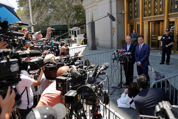 Lawyers Brad Edwards and David Boies speak to reporters outside the courthouse after a bail hearing in U.S. financier Jeffrey Epstein's sex trafficking case in New York City