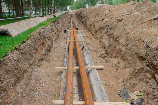The process of repair of urban heating pipe systems.