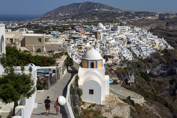 Fira is the capital of Santorini, a Greek island in the Aegean Sea, located on clifftop with views of Nea Kameni, a still-active volcanic island.