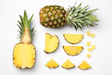 Fototapete - Flat lay composition with cut and fresh juicy pineapples on white background