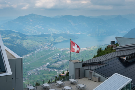View from Stanserhorn with the swiss flag and a restaurant