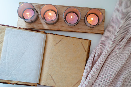 photo album on the table and candles. the cloth. background.