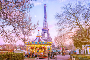 The Eiffel Tower and vintage carousel on a winter evening in Paris, France. Wall mural