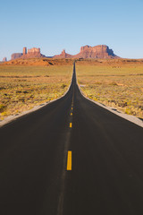 Fototapete - Classic highway view in Monument Valley at sunset, USA