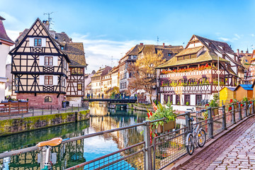 Traditional half-timbered houses on picturesque canals in La Petite France in the medieval fairytale town of Strasbourg, UNESCO World Heritage Site, Alsace, France. Wall mural