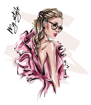 Hand drawn beautiful young woman in sunglasses. Stylish girl in pink dress. Fashion woman look. Sketch. Vector illustration.