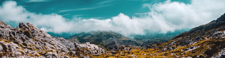 Beautiful wide mountain panorama views with the wild nature and low clouds hanging in the tops. Serra de Tramuntana, Mallorca, Spain , Balearic Islands Fototapete